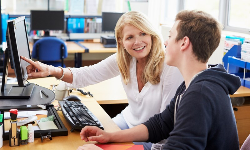picture of teacher and student at a computer